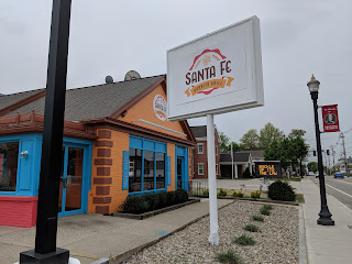 The new Santa Fe Grill has their signs up on their brightly colored building.