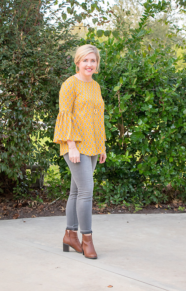 mustard bell sleeve top, grey skinny jeans, cognac booties, fall fashion, womens fashion