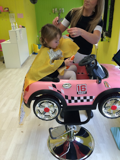 toddler getting hair cut at pikku