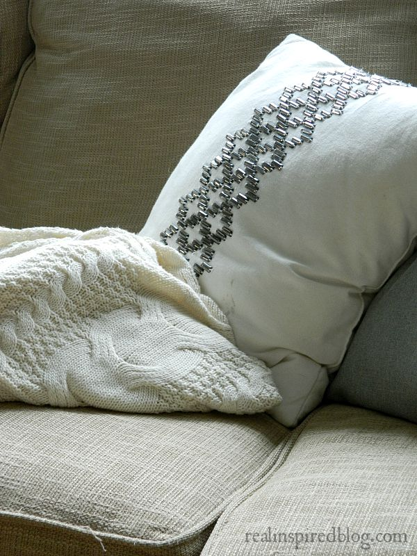 Cozy sweater blanket and a glittery glam pillow.