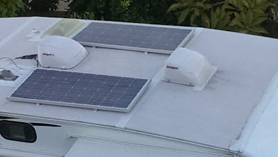 Two solar panels on the roof of our trailer. Nice to have when boondocking.