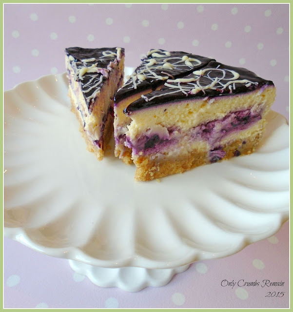 How to make a layered baked cheesecake like this Bilberry and White Chocolate one.