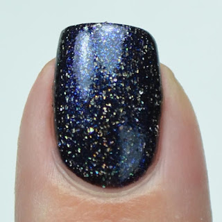 black nail polish with holo flake