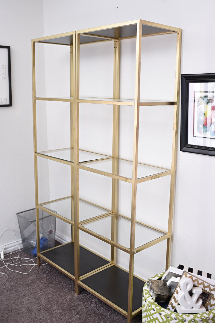 DIY tutorial: IKEA VITTSJO shelving unit hack using gold spray paint and the best marble contact paper. The end result looks amazing in the blogger's black, white and gold home office.