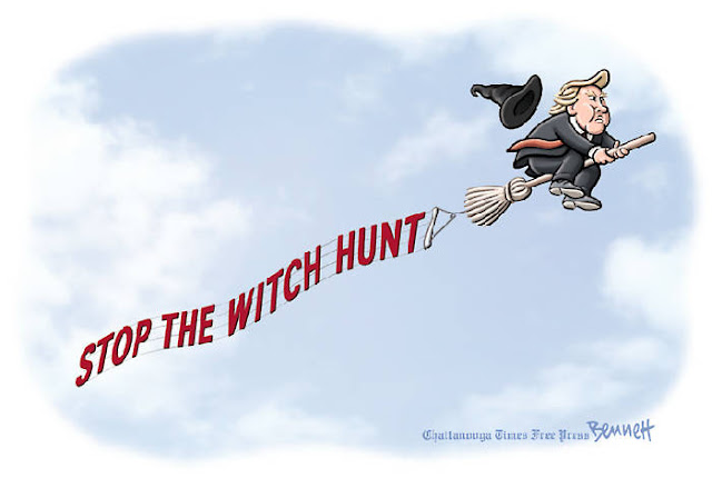 Donald Trump flying through the air riding a broom and trailed by a witch's hat towing a banner that says