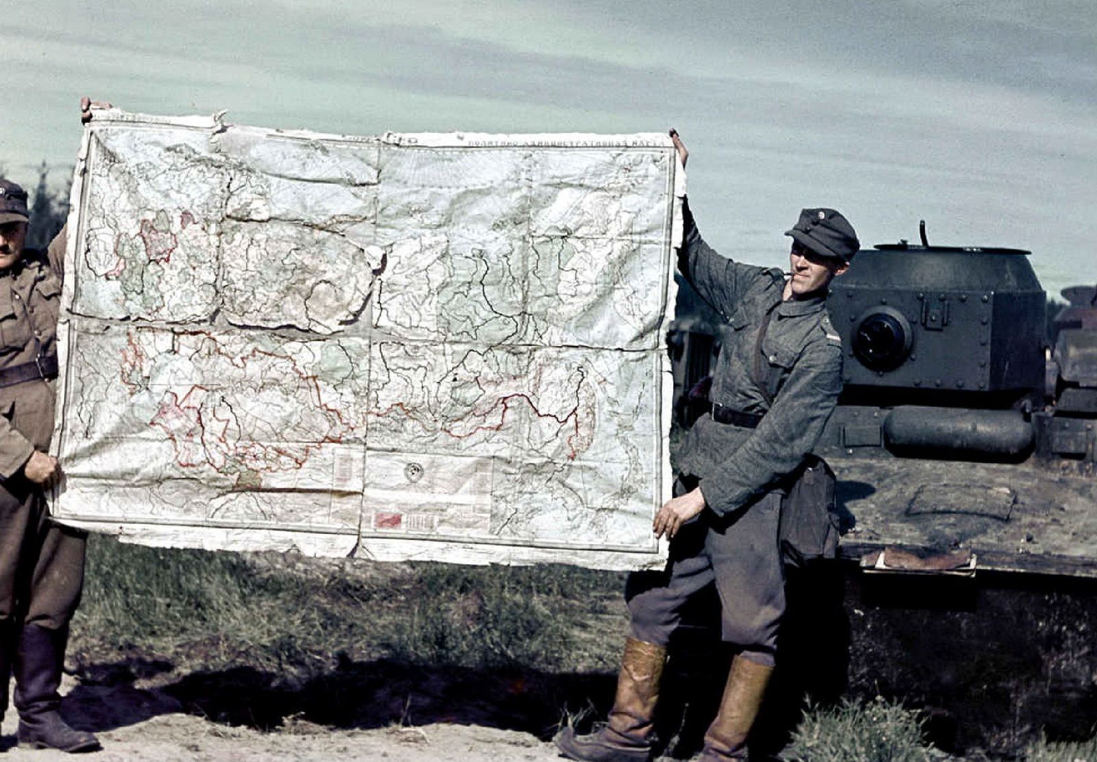 World war ii in color finnish soldiers displaying a map of the finnish soldiers displaying a map of the soviet union captured at the porlampi motti gumiabroncs Image collections