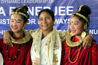 West Bengal chief minister Mamata Banerjee with gorkha girls wearing traditional attire
