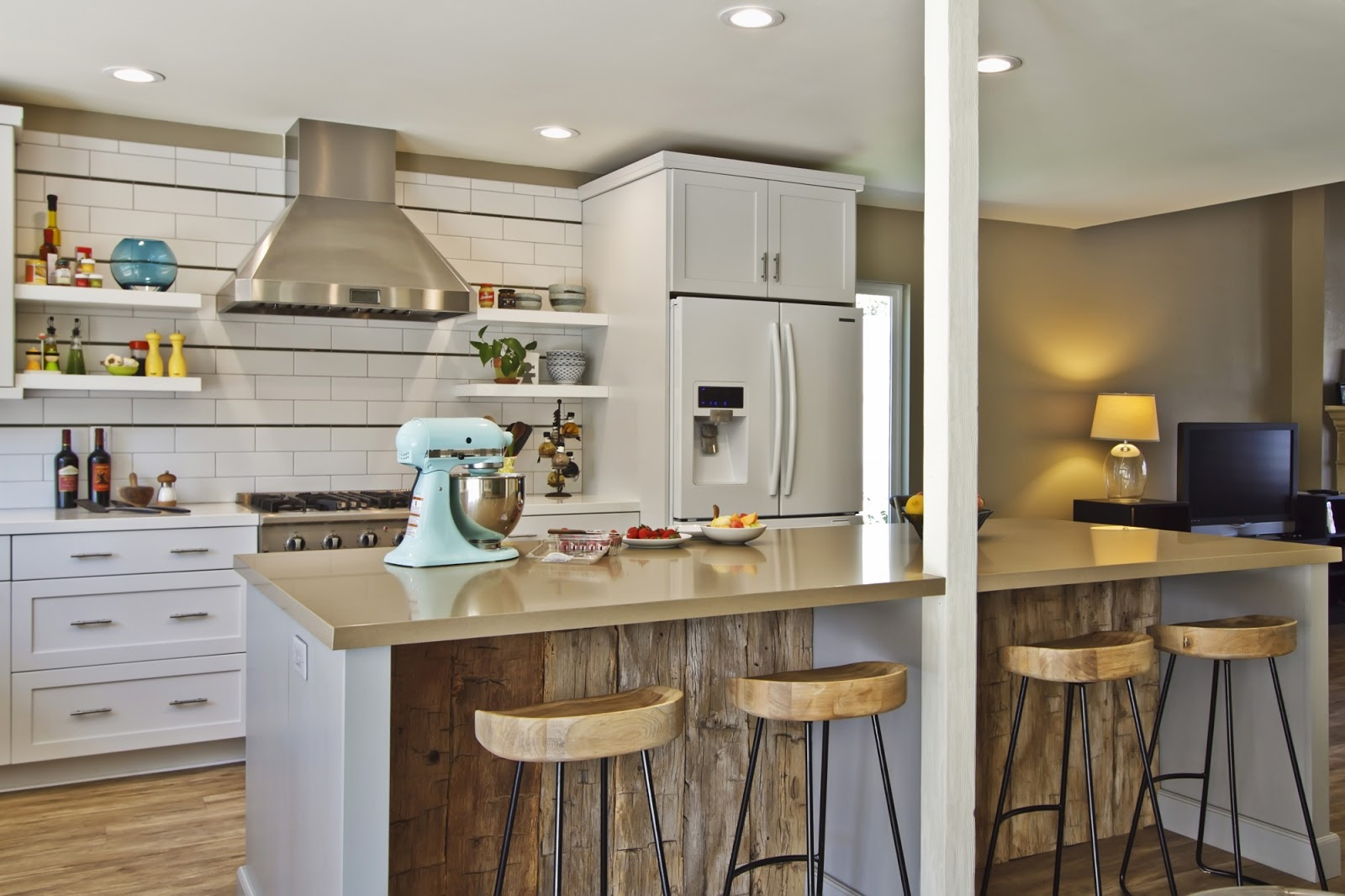 10 kitchens with quartz countertops kitchen countertops quartz Countertops are CaesarStone Notice that the island is a sand color and the stove run counters are white Photo Cultivate