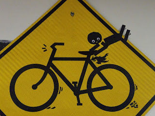 bicycle safety yield sign decorated with a person flying off