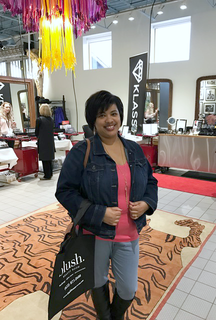 a woman standing at the Beauty Summit