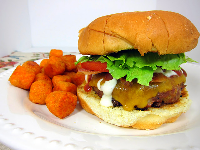 BBQ Ranch Burgers - hamburgers with cheese, bbq sauce and ranch dressing mixed in the patties. Top with cheddar cheese, bacon, and more BBQ sauce and Ranch dressing. SOOO good! Double the batch and freeze extra for a quick meal later! Our go-to burger recipe!