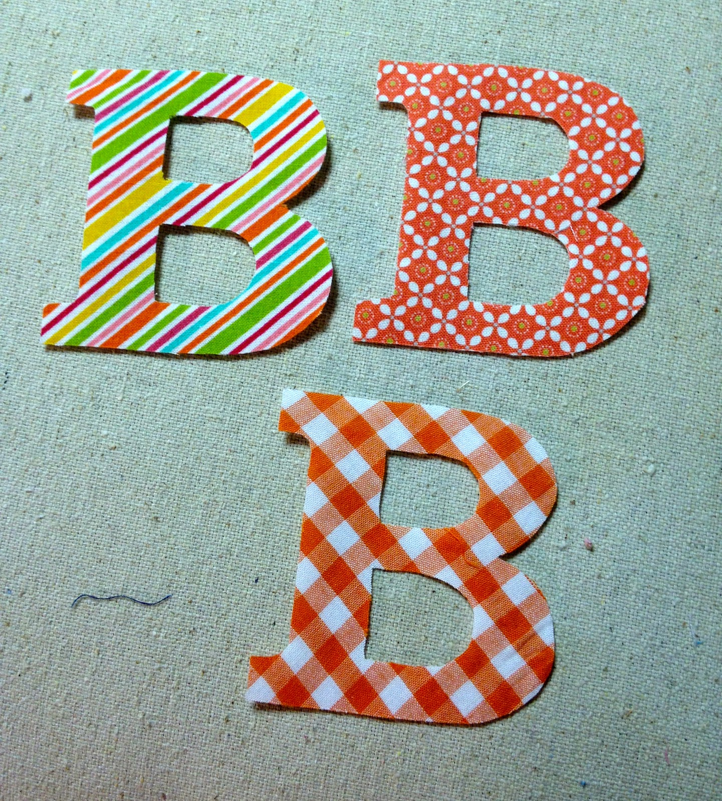 fa55d8fa6e94 (For more on how to make fabric letters see my post here.) 5.
