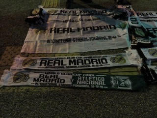 Real Madrid and Atletico Nacional half and half scarves.