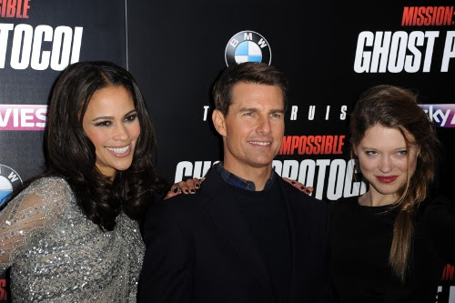 Atores Paula Patton, Léa Seydoux e Tom Cruise possam para foto em evento de promoção do filme Missão Impossível Protocolo Fantasma