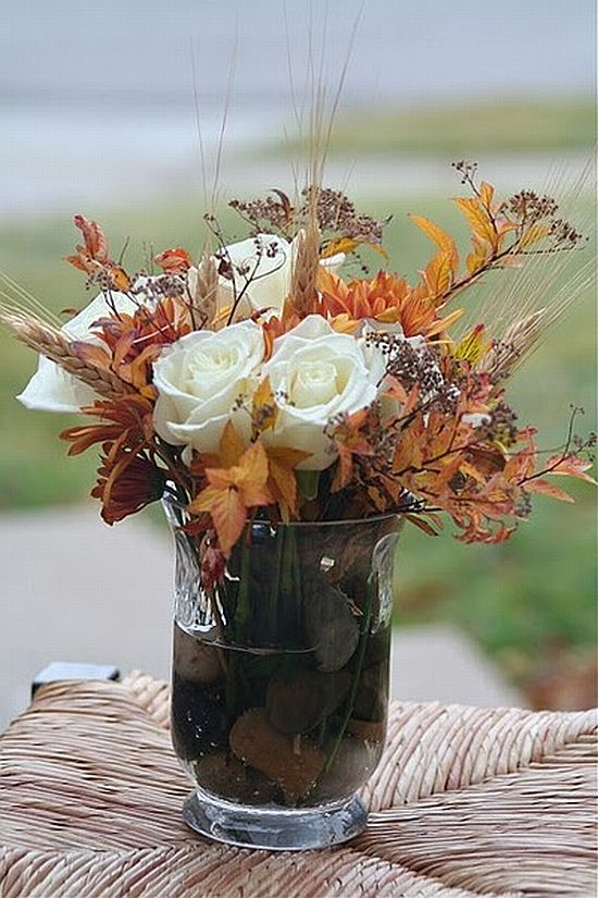 pretty fall flower decoration with white roses and leaves