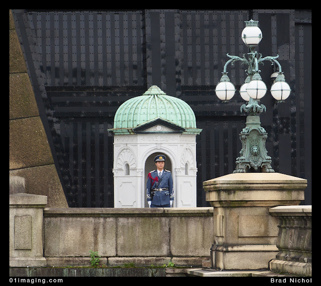 Guard at front gates of imperial palace, tokyo, japan,