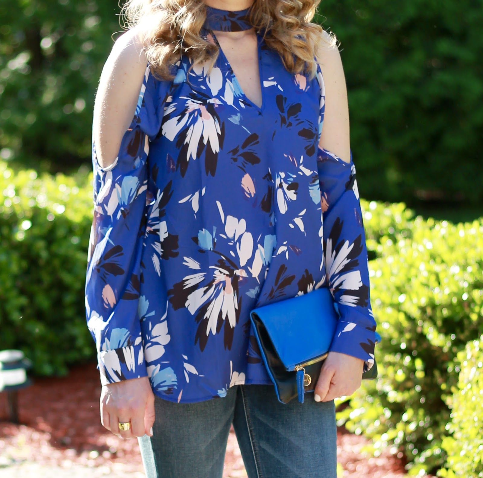 Jessica Simpson maternity jeans, grey studded flats, blue Clare V. fold over clutch, blue floral choker cold shoulder top