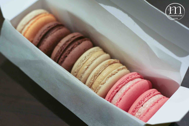 Different macaron flavors inside a box