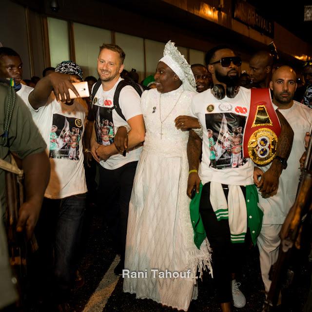 Photos of boxing champ Larry Ekundayo