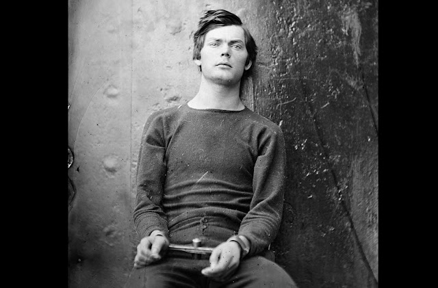 Conspirator Lewis Powell (Payne), in a sweater, seated and manacled in the Washington Navy Yard, Washington D.C. in April of 1865. Powell attempted unsuccessfully to assassinate United States Secretary of State William H. Seward in his home on April 14, 1865. he was soon caught, and became one of four people hanged for the Lincoln assassination conspiracy.