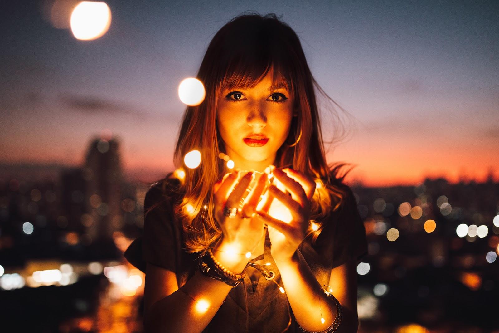 Woman Holding Fireflies