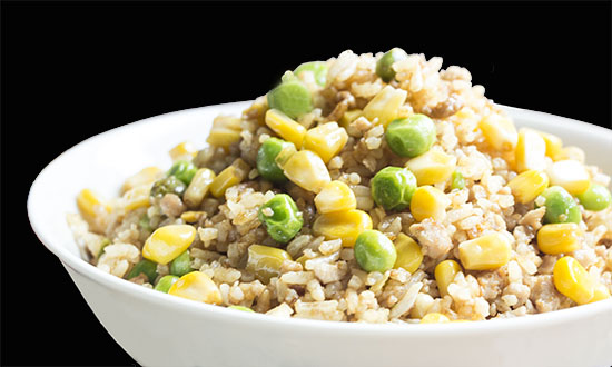 Chinese food - Rice fried with minced pork, peas and corn seeds
