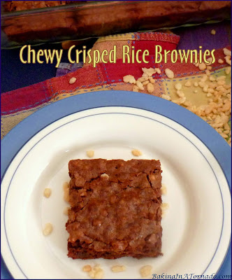 Chewy Crisped Rice Brownies are a dense chocolatey treat with crisped rice for a chewy and crispy texture. | Recipe developed by www.BakingInATornado.com | #recipe #chocolate