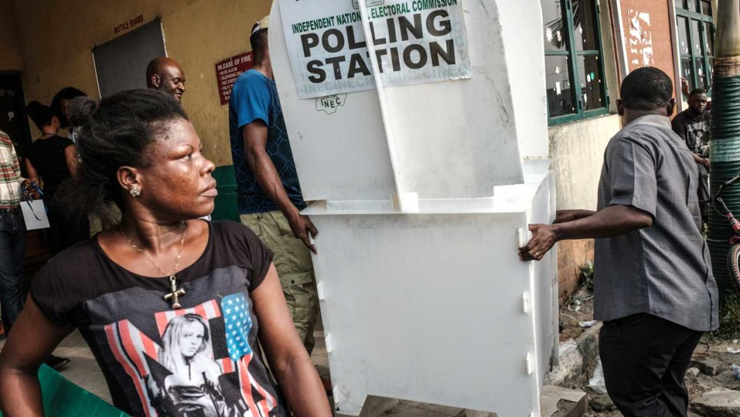 c06554390f9b Staff of the Independent National Electoral Commission (INEC) carry an  installed ballot stand at a polling station. PHOTO  Yasuyoshi CHIBA   AFP