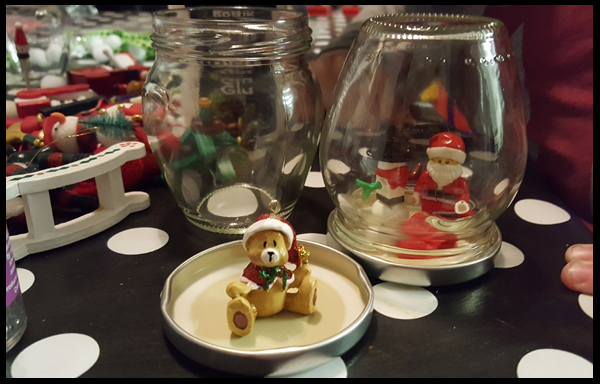 Adding an ornament to snow globes