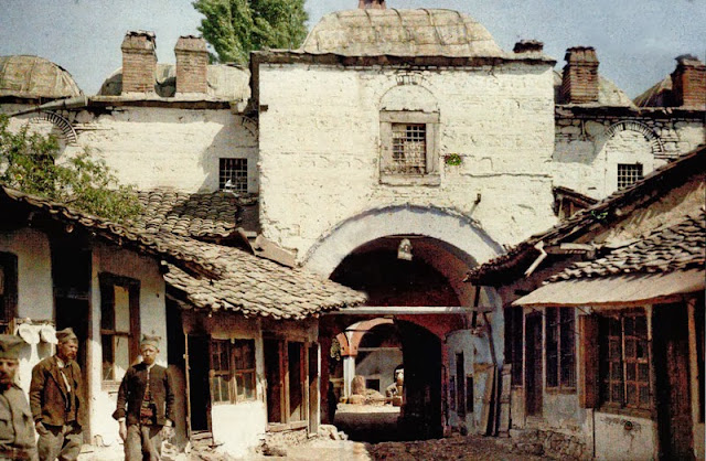 The main entrance of Kursumli-an (leaded khan), one of Skopje's many caravanserais, built around the middle of the 16th century by Mula Musledin Hodja, son of Abdul Gani. Before the Second World War (in 1925) it was transformed into a lapidary section of the Archaeological Museum, a function it still retains today. On both sides of the entrance there are rows of shops with characteristic wooden shutters for the shops of the former Skopje shopping district. - Macedonia in 1913