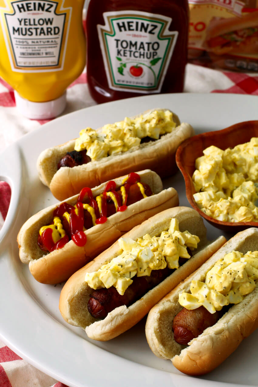 Bacon Wrapped Egg Salad Dogs are made by wrapping hot dogs with smoky bacon and topping them with creamy egg salad. You'll want to make this delicious spin on the classic hot dog all summer long! #ad #hotdogs