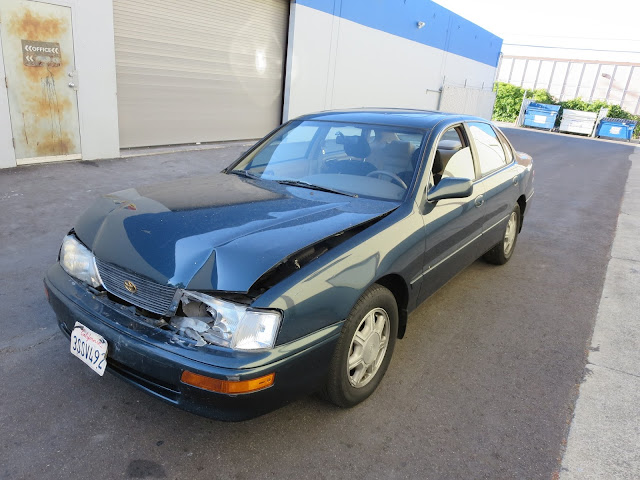 Toyota Avalon with collision damage before repair at Almost Everything Auto Body