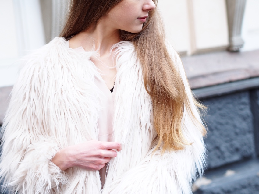 White faux fur jacket from sisters point