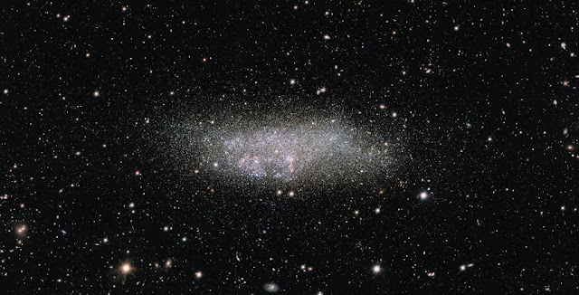 This image, captured by ESO's OmegaCAM on the VLT Survey Telescope, shows a lonely galaxy known as Wolf-Lundmark-Melotte, or WLM for short. Although considered part of our Local Group of dozens of galaxies, WLM stands alone at the group's outer edges as one of its most remote members. In fact, the galaxy is so small and secluded that it may never have interacted with any other Local Group galaxy — or perhaps even any other galaxy in the history of the Universe. Credit: ESO