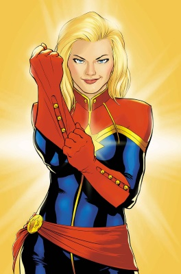 Illustration of a blonde white woman in a red, blue, and gold flight suit. She pulls on one red glove as she stares directly at the viewer.