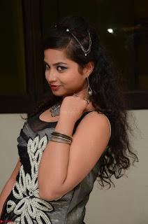 Shrisha Dasari in Sleeveless Short Black Dress At Follow Follow U Audio Launch 042.JPG