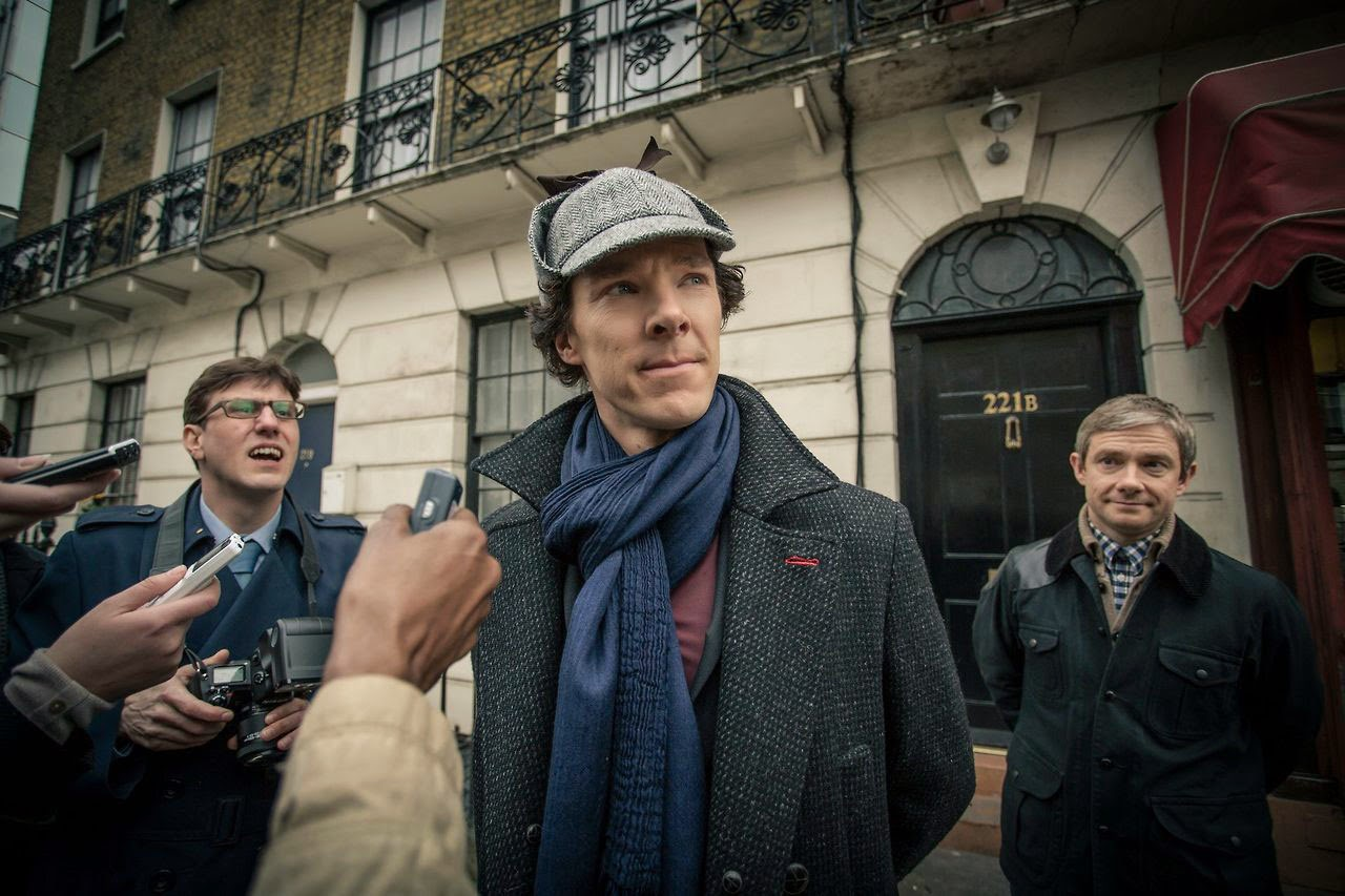 Benedict Cumberbatch as Sherlock Holmes wearing deerstalker with Martin Freeman as John Watson in BBC Sherlock Season 3 Episode 1 The Empty Hearse
