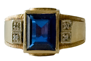 A vintage man's sapphire ring with gold band.