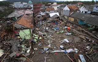 Debris of shattered properties after flash flood hit the province.