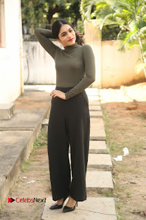 Tollywood Actress Punarnavi Bhupalam Latest Po Gallery in Black Trouser Pant at Pittagoda Movie Interview  0132.JPG