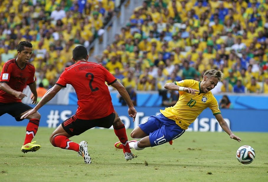 Brazil's Neymar (10) is tripped by Mexico's Francisco Rodriguez (2) during the group A World Cup soccer match between Brazil and Mexico at the Arena Castelao in Fortaleza, Brazil, Tuesday, June 17, 2014.