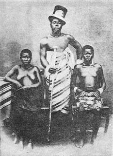Man with several women standing around him
