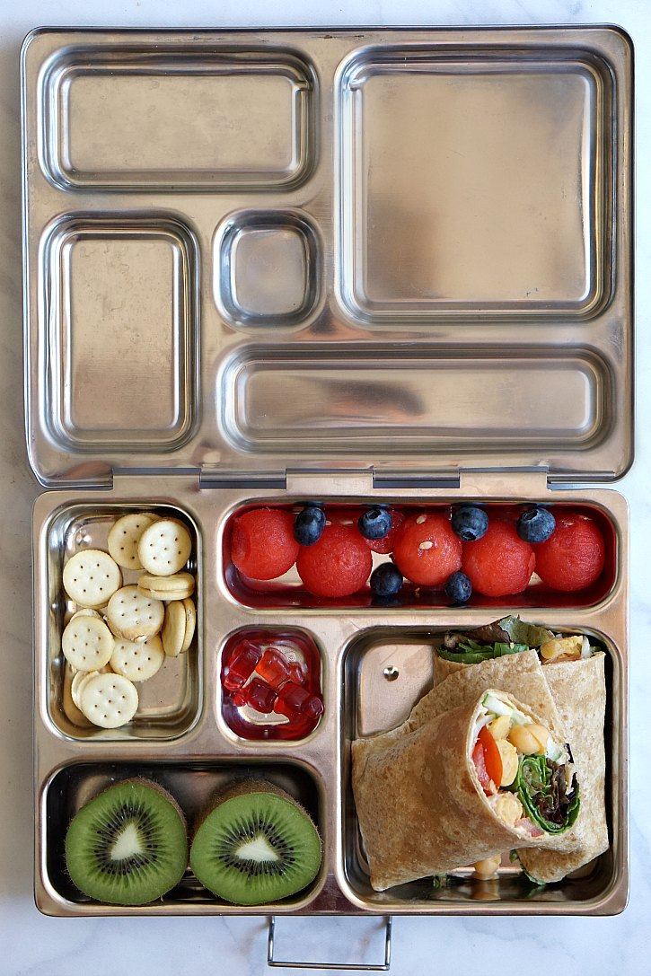 Vegetarian packed lunch with a Mediterranean wrap.