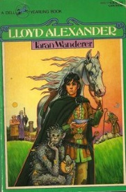 Cover of Taran Wanderer. A young white man with shoulder-length black hair stands in the centre, holding the bridle of a silver horse. A monkey-like person crouches at his feet. The man wears medievalesque clothing, including a heavy green cloak, and holds a small bowl in one hand. Two indistinct figures stand behind him to the viewer's left with the sun hovering over them. To the right is a shepherd with a crescent moon above him.