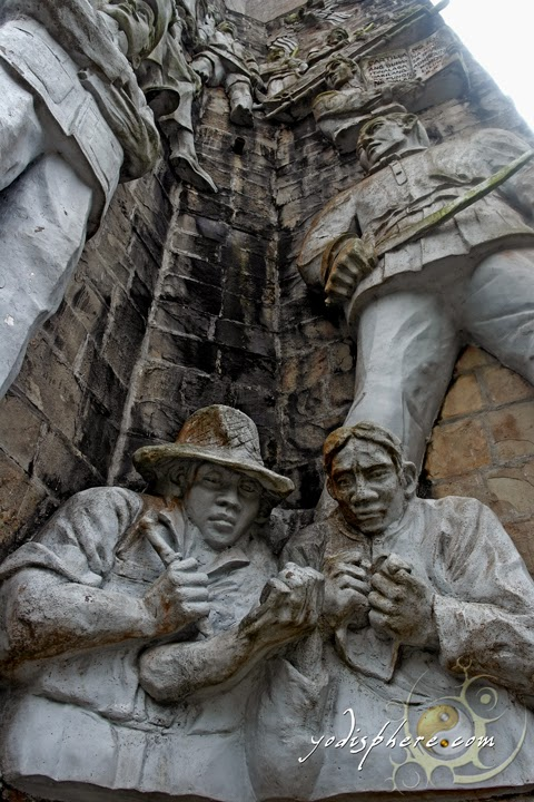 Sculptures called the Nabiag na Bato at the base of the Memorial Cross at Mt. Samat