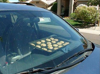 sheet of cookies baking on car's dashboard