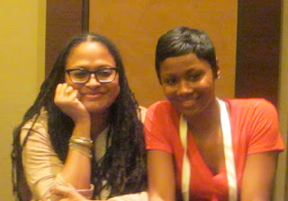 Ava Duvernay and Emayatzy Corinealdi sit at a panel table.
