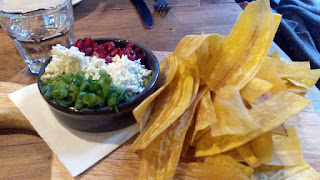 Luxurious guacamole with plantain chips.