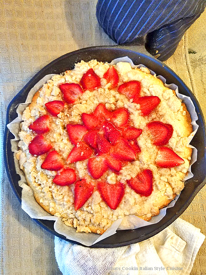 this is a recipe on how to make an old fashioned buttermilk strawberry baked shortcake in a cast iron skillet with streusel topping