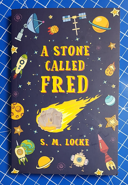 A Stone Called Fred by S.M.Locke Young Adult Fiction book cover showing cartoon space theme